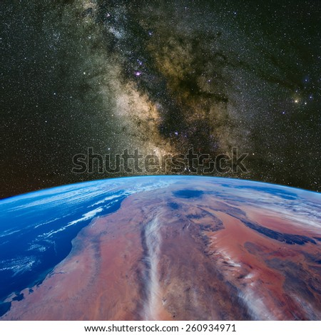 Libya from space with the Milky Way above. Elements of this image furnished by NASA.  - stock photo