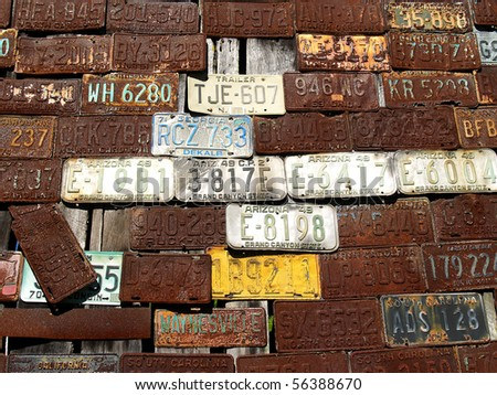 License plates on the wall - stock photo