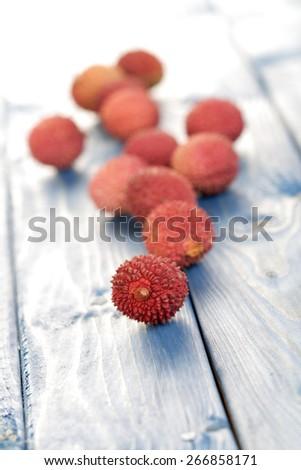 Lichee on wooden table - studio shot - stock photo