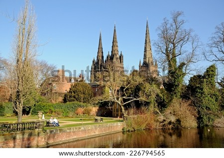LICHFIELD, UNITED KINGDOM - MARCH 9, 2014 - Cathedral and Remembrance Gardens seen across Minster Pool, Lichfield, Staffordshire, England, UK, Western Europe, March 9, 2014. - stock photo