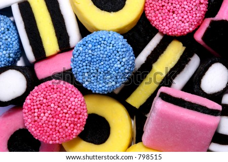 Licorice allsorts sweets forming a background.. - stock photo