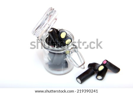 Licorice candy in a jar on a white background - stock photo