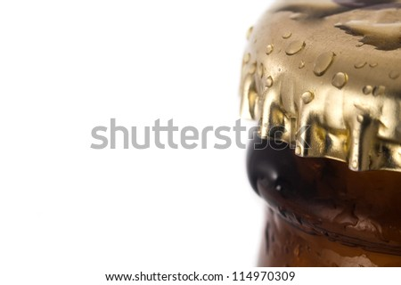 lid on brown beer bottle, detail photo, white background - stock photo