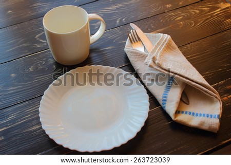 lie on a tree plate, fork knife worth cup - stock photo