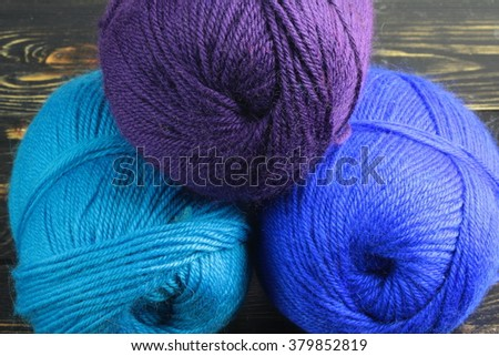 lie on a wooden board thread for knitting three different colors