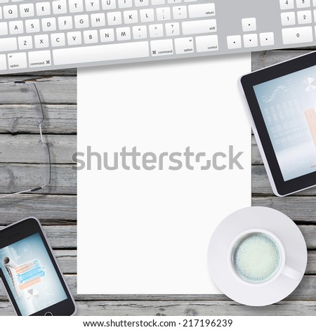Lie on wooden floor smartphone, tablet and empty paper sheet