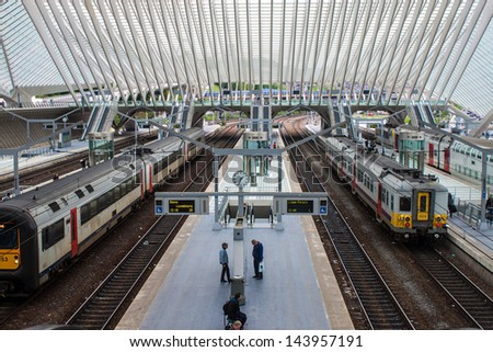 LIEGE, BELGIUM - MAY 13: Futuristic Liege-Guillemins railway station on May 13, 2013 in Belgium. Station is made of steel, glass and white concrete by Spanish architect Santiago Calatrava. - stock photo