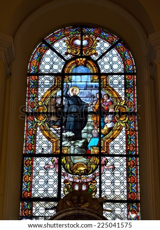 LIEGE, BELGIUM-OCTOBER 19, 2014: Stained glass window in Collegiate church of Saint-Denis of Liege. The church was founded in 10 century and organ was built in 1589