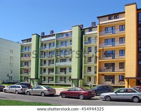 LIEPAJA, LATVIA - JULY 19, 2016: Newly built green color apartment house is located on Daugavas street. - stock photo
