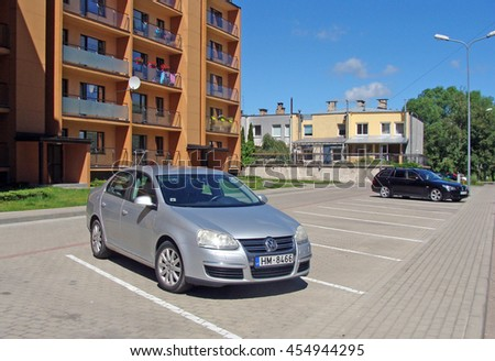 LIEPAJA, LATVIA - JULY 19, 2016: On Daugava street newly built apartment houses have separate individual marked parking places with electronic lifting barrier and radio trigger.