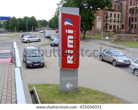 LIEPAJA, LATVIA - JUNE 10, 2016: Big sign is pointing to hypermarket Rimi store in shopping center Ostmala.                                - stock photo
