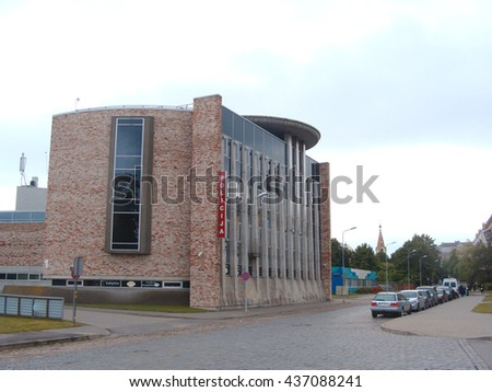 LIEPAJA, LATVIA - JUNE 10, 2016: On Barinu street is located police office building with chopper landing place on the roof.                                - stock photo