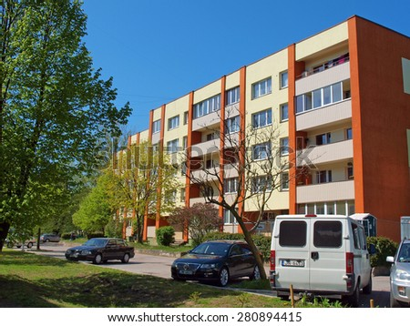 LIEPAJA, LATVIA - MAY 21, 2015: Multi-storey apartment house is renewed and repainted and ready for use. - stock photo