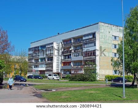 LIEPAJA, LATVIA - MAY 21, 2015: Vintage multi-storey apartment house is waiting for renovation.       - stock photo