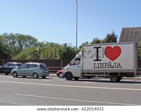 LIEPAJA, LATVIA - MAY 17, 2016: White color deliveries truck is driving down the street. - stock photo