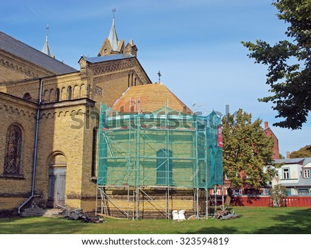 LIEPAJA, LATVIA - OCTOBER 4, 2015: Roof repair begins in historical building of Saint Josepha`s Catholic Cathedral located on Rakstvezu street. - stock photo