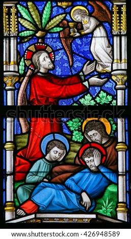 LIER, BELGIUM - MAY 16, 2015: Stained Glass window in St Gummarus Church in Lier, Belgium, depicting Jesus in the Garden of Gethsemane - stock photo