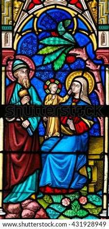 LIER, BELGIUM - MAY 16, 2015: Stained Glass window in St Gummarus Church in Lier, Belgium, depicting the Holy Family, Joseph, the Virgin Mary and the Infant Jesus.
