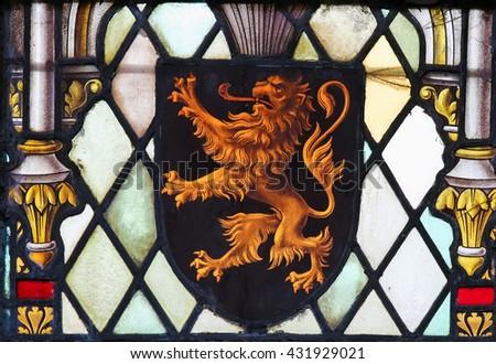 LIER, BELGIUM - MAY 16, 2015: Stained Glass window in St Gummarus Church in Lier, Belgium, depicting the Coat of Arms of Brabant in Belgium. - stock photo