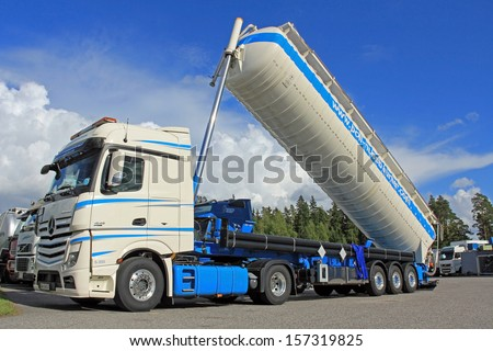 LIETO, FINLAND - AUGUST 31: Mercedes-Benz Actros silo truck for dry bulk transport on August 31, 2013 in Lieto, Finland. Dry bulk shipping stocks soar in August, and the long-term trend is improving. - stock photo