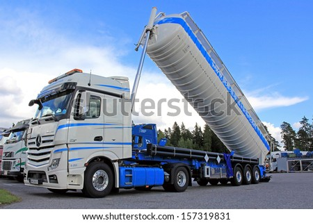 LIETO, FINLAND - AUGUST 31: Mercedes-Benz Actros tipping silo truck on August 31, 2013 in Lieto, Finland. Dry bulk shipping stocks soar in August, and the long-term trend is improving. - stock photo