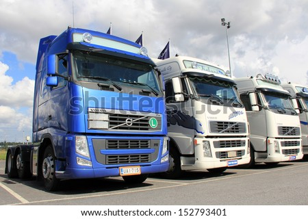 LIETO, FINLAND - AUGUST 31: Row of Volvo trucks on August 31, 2013 in Lieto, Finland. According to Volvo Group, one third of all goods traffic on the European roads involves the transport of food. - stock photo
