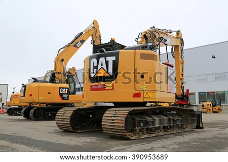 LIETO, FINLAND - MARCH 12, 2016: Cat 314E LCR and 313 F hydraulic excavators along with other Cat construction equipment seen at the public event of Konekaupan Villi Lansi Machinery Sales.  - stock photo