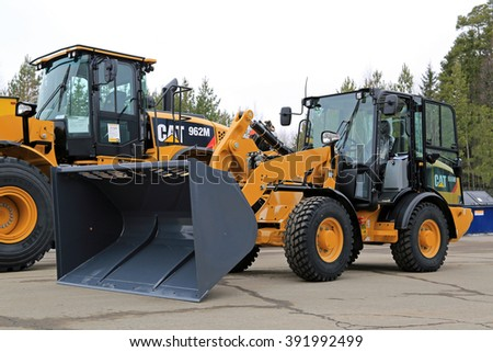 LIETO, FINLAND - MARCH 12, 2016: Cat 906M Compact wheel loader and other Cat construction equipment as seen at the public event of Konekaupan Villi Lansi Machinery Sales.  - stock photo