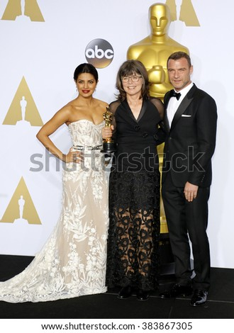 Liev Schreiber, Margaret Sixel and Priyanka Chopra at the 88th Annual Academy Awards - Press Room held at the Loews Hollywood Hotel in Hollywood, USA on February 28, 2016. - stock photo