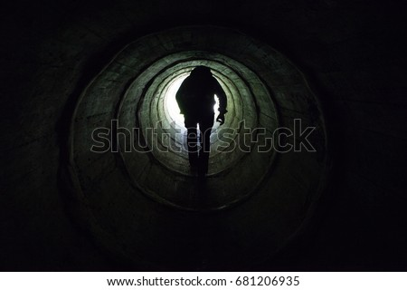 Life after death concept, the light at the end of the dark tunnel