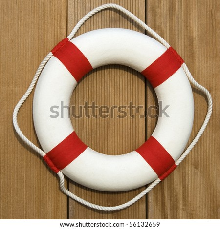 Life belt on wooden wall - stock photo