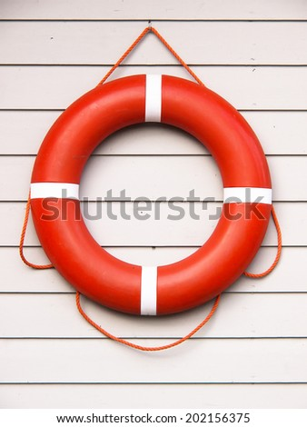 life belt, rescue ring on wooden wall - stock photo