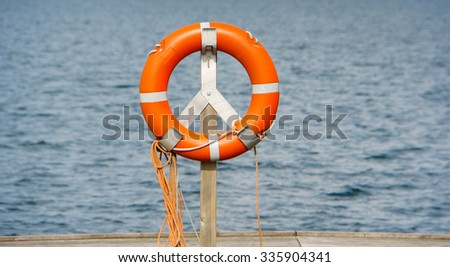 life belt, rescue ring water in background - stock photo