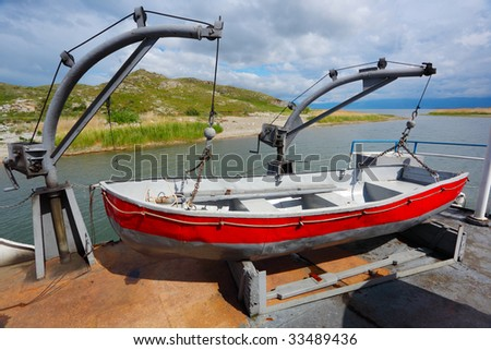 Life boat by the big ship - stock photo