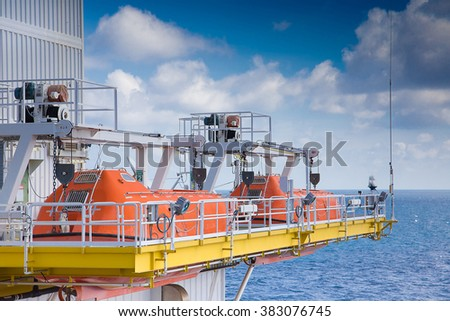 Life boat stand by at muster point for emergency evacuation. - stock photo