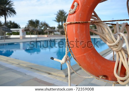 life buoy at swimming pool in tunisia - stock photo