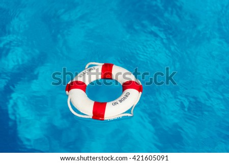 Life buoy floating on water with text welcome on board - stock photo