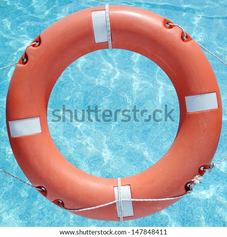 Life buoy in the swimming pool - stock photo