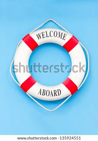 Life buoy isolated on blue. - stock photo