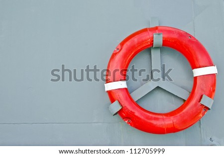 Life buoy on the battleship wall
