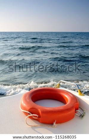 Life buoy on the boat - stock photo