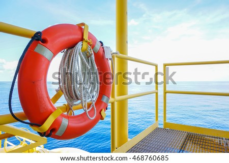 Life buoy or Ring buoy and rope is safety equipment for rescue worker or man over board in petroleum offshore wellhead remote platform,  Energy and petroleum industry is major of the world.