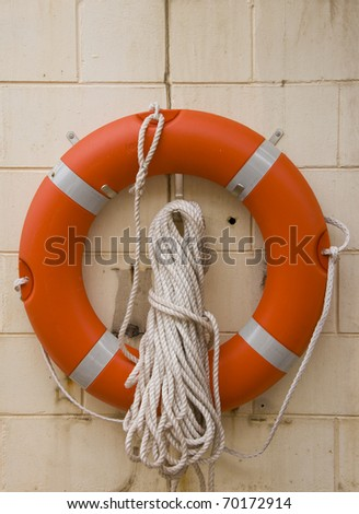 Life buoy with rope. - stock photo