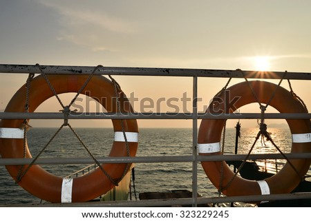 life buoys on passenger vessels - stock photo