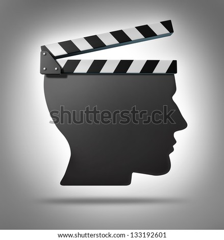 Life direction and human guidance as a symbol of a movie equipment clapboard shaped as a head ins a concept for living and taking action in your biography. - stock photo