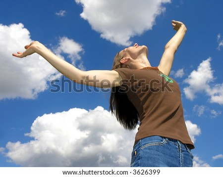 Life is beautiful .Young woman and clouds  . - stock photo