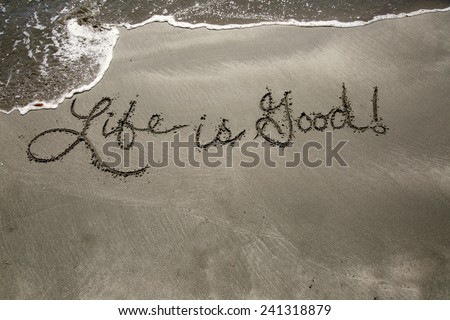Life is good, a message written in the sand at the beach.