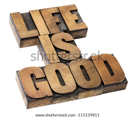 life is good - positivity concept - isolated text in vintage letterpress wood type - stock photo