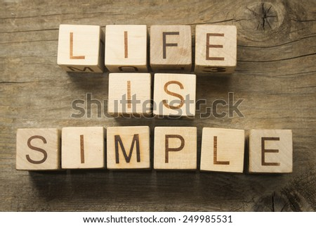 Life is simple text on a wooden cubes