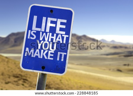 Life is What You Make It sign with a desert background - stock photo